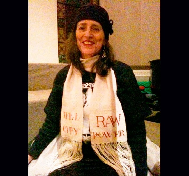 "Maria Damon wearing her ""Raw Power"" scarf, St. Marks Church, NYC. Photo by Megan Cump."